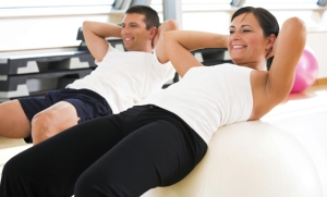 Young adults doing exercises at the fitness club